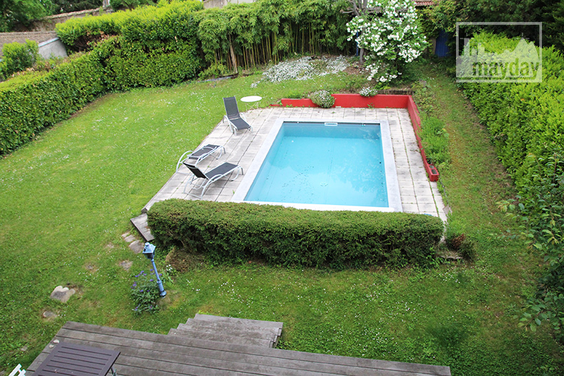 clav0040-maison-50s-ouverte-jardin-1